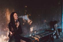 Young Woman Smoking Electronic...