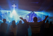 canvas print picture - Christmas concept: Blurred Christian Congregation Worship God together in Church hall in front of music stage and light effected