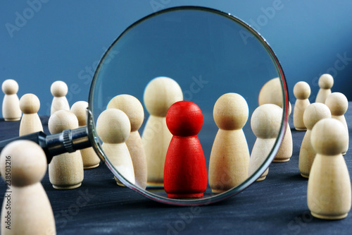 Obraz HR human resources and Recruitment concept. Wooden figures and magnifying glass. - fototapety do salonu
