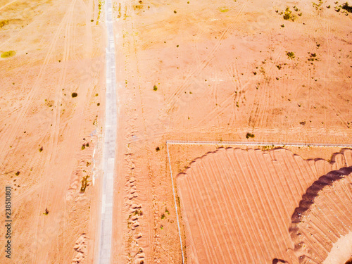 Staande foto Vintage Poster Aerial view of road with. Aerial view of a country road with sand. Car passing by. Aerial construction road. Aerial view flying. Captured from above with a drone.