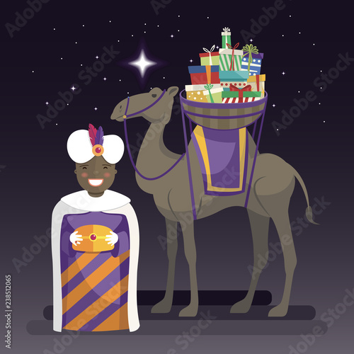 Three kings day with King Balthazar, camel and gifts at night Canvas Print