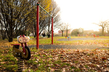 Motorcycle Spring Rider In Playground In Autumn