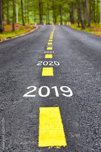 Fotografering  Number of 2019 to 2023 on asphalt road surface with marking lines, happy new yea