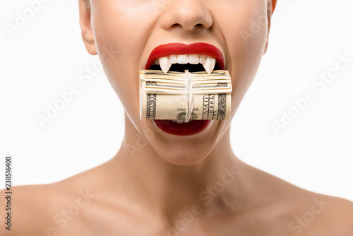 cropped shot of naked girl with vampire teeth holding rolled dollars in mouth is Canvas Print