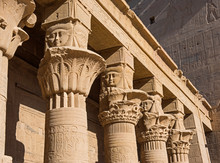 Hieroglyphic Carvings On Columns At An Ancient Egyptian Temple