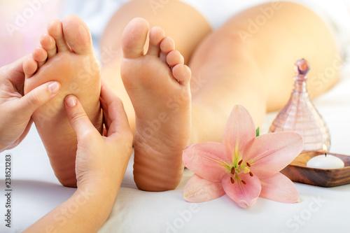 Obraz Reflexologist massaging female feet. - fototapety do salonu