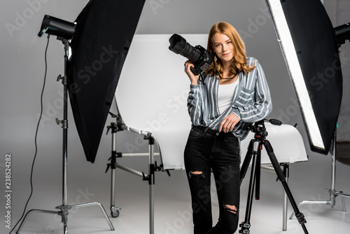 attractive young female photographer working in professional photo studio Canvas Print