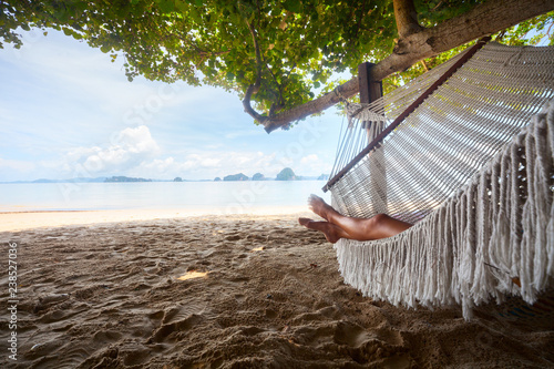 Foto op Aluminium Ontspanning Young lady relaxing in the hammock