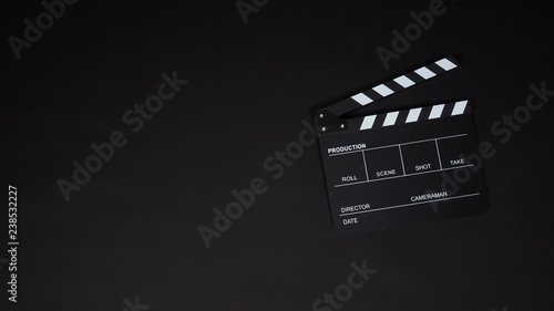 Black Clapperboard or clap board or movie slate use in video production ,film, cinema industry on black background Wallpaper Mural