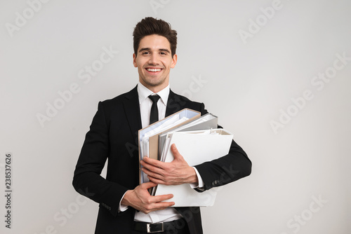 Tired business man wearing suit standing