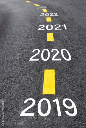 Fotografia  Number of 2019 to 2023 on asphalt road surface with marking lines, happy new yea