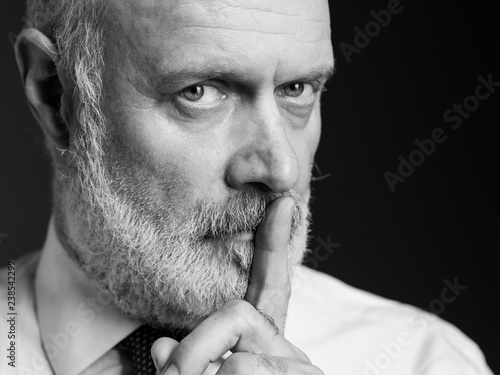 Businessman asking for silence