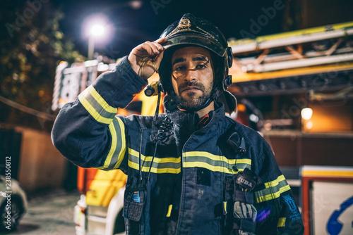 Fireman man posing to camera.