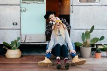 Young Couple Sitting On Caravan