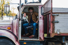 Cool Young Man Sitting In A Broken Truck