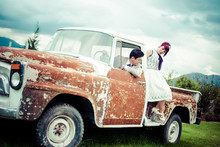 Husband Drives His Wife In An Old Truck