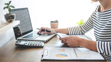 Female Accountant Analyzing Fi...