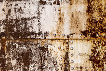 Textured Rusted Sheet Of Metal With A Lot Of Bolts