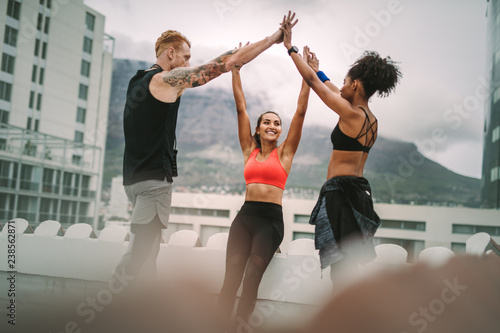 Fitness people celebrating after workout