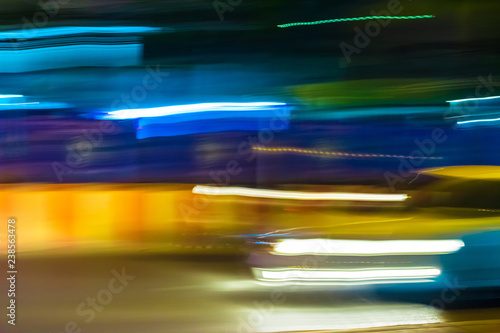 Long exposure night time traffic trails with vibrant neon colors Poster Mural XXL