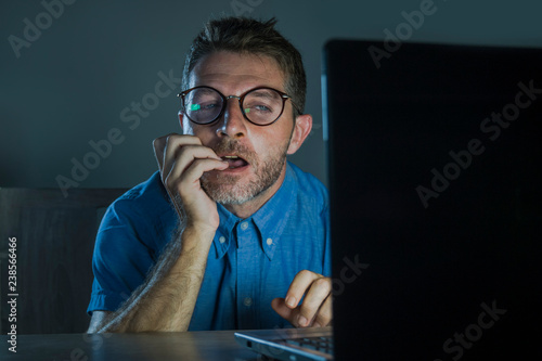 Photo lascivious aroused porn addict man in nerd glasses watching sex movie online lat
