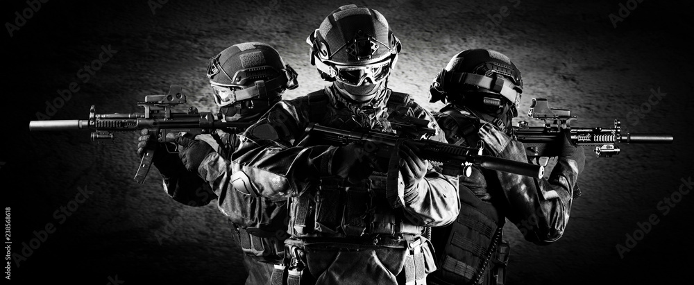 Fototapety, obrazy: Group of fighters of a special unit covers the withdrawal of members of their team.
