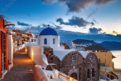 Beautiful view of Santorini island in Greece at sunrise with dramatic sky.