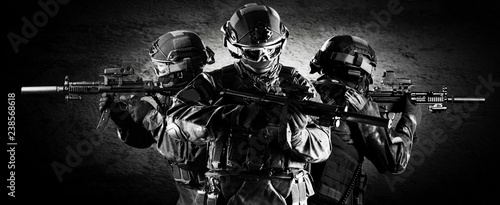 Photo  Group of fighters of a special unit covers the withdrawal of members of their team