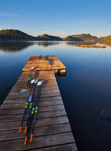 Oars For Kayaks Lie On The Dock