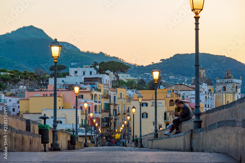 Fotografía  Sunset view Ischia street with colourful houses, Italy