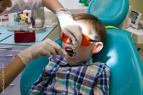 Reception at the dentistry  The dentist examines the oral cavity