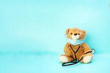 Teddy Bear On Medical Backgroud With Space Fo Text