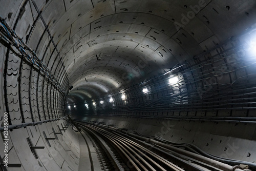 round underground winding subway tunnel going into the distance