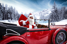 Santa Claus In A Red Car On Ch...