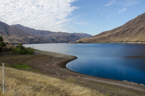 Fotografie, Obraz  Extreme Drought Conditions as Water Levels Drop in Reservoir