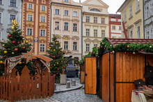 Old Town Square With View Of The Old Town Hall With Christmas Market And Christmas Trees In Prague. Czech Republic