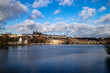 Prague, Czech Republic, Europe, panorama overlooking the historic buildings of Prague Castle, Charles Bridge and the Vltava River in front of interesting blue sky with clouds