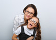 canvas print picture - Happy young mother and lauging kid in fashion glasses hugging on empty copy space