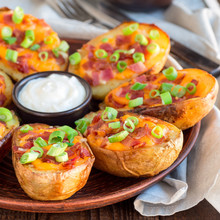 Baked Loaded Potato Skins With Cheddar Cheese And Bacon, Garnished With Scallions And Sour Cream, Square Format