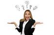 canvas print picture - Junge Geschäftsfrau mit ratloser Geste und von Fragezeichen umgeben
