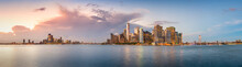 New York City Financial District Skyline Panorama From Across The Harbor At Dusk.