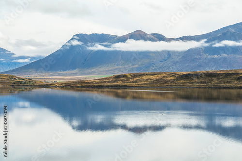 Aluminium Prints Dark grey Water reflection on silent lake in Iceland