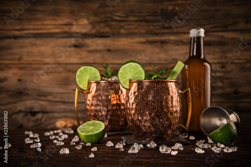 Poster Cocktail Famous Moscow mule alcoholic cocktail in copper mugs.