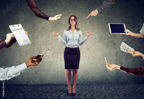 business woman is meditating to relieve stress of busy corporate life - 238632438