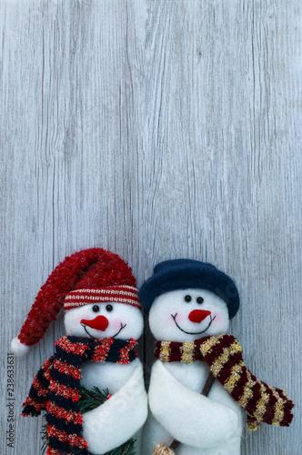 Fotografie, Obraz  Christmas still life snowmen decorations on white wooden plank background