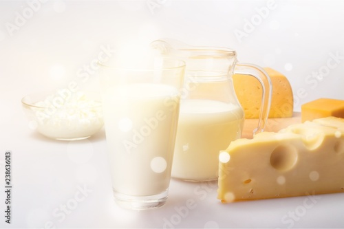 Dairy Products- Cheeses and Milk on the Grey Background
