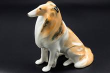 Antique Porcelain Statuette Of...