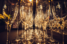 Empty Champagne Glasses In Row On Evening Event Party Waiting For The Guests