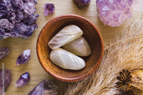 Fényképezés Teak Bowl of Moonstone with Amethyst Crystals and Dried Poppy Flower