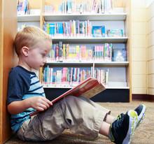 Preschool Child Reading A Book...
